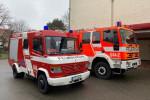 Vorauslöschfahrzeug und Löschgruppenfahrzeug nebeneinander vor dem Feuerwehrhaus